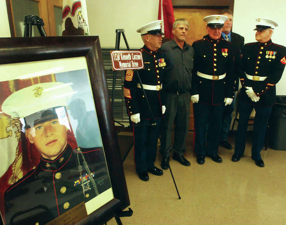 "U.S. Marine Corps. veterans and family members of Lance Cpl. Kenneth A. ""Kenny"" Corzine stand for photos Saturday following a ceremony honoring the fallen soldier. Pictured, from left, are Ed Irvin, Kenneth Corzine (Kenny's father), Bernie Caldwell, Jim Corzine (Kenny's uncle) and Robert Miller. Corzine, a Bethalto native, died in 2010 from injuries he suffered in combat while serving in Afghanistan. The ceremony, held at the Bethalto Community Center was to name name Illinois Route 140 from North Bellwood Drive to Prairie Street in Bethalto ""LCpl. Kenneth Corzine Memorial Drive."" Photo: Nathan Woodside 