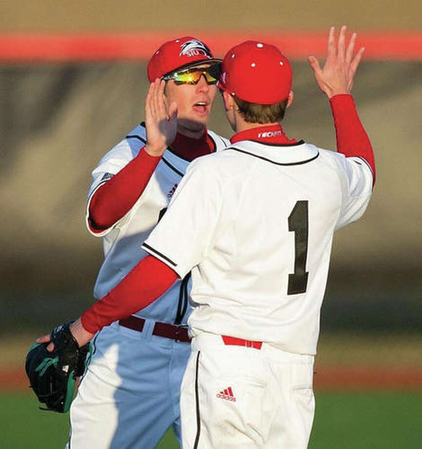 SIUE's Alec Skender (1) and a teammate celebrate during the Cougars' series-opening victory over Northern Illinois on Friday at Roy E. Lee Field in Edwardsville. SIUE completed the four-game sweep of Northern Illinois on Sunday. Photo: SIUE Athletics