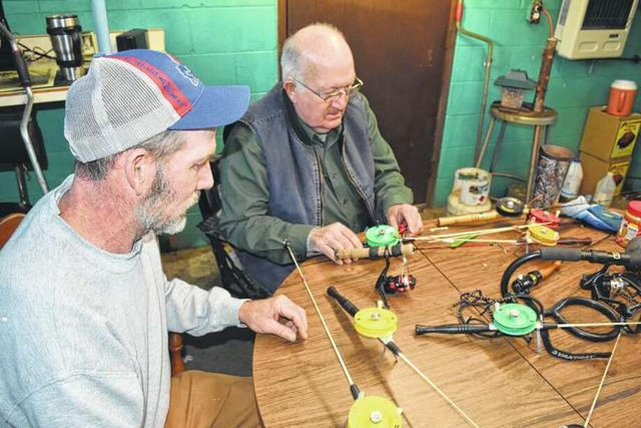 Jay Toler of Franklin (left) and Ned Seymour of rural Franklin inspect their ice-fishing poles and equipment. Photo: Greg Olson   Journal-Courier