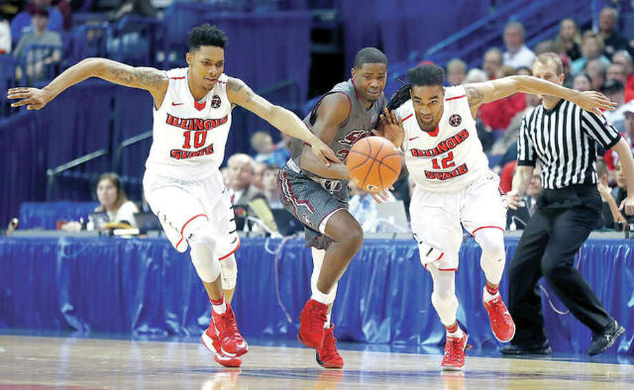 Illinois State's Phil Fayne (10) and Tony Wills (12) chase the ball along with SIU Carbondale's Armon Fletcher during the Missouri Valley Conference Tournament semifinals Saturday in St. Louis. Fletcher is an Edwardsville High grad. Photo: AP