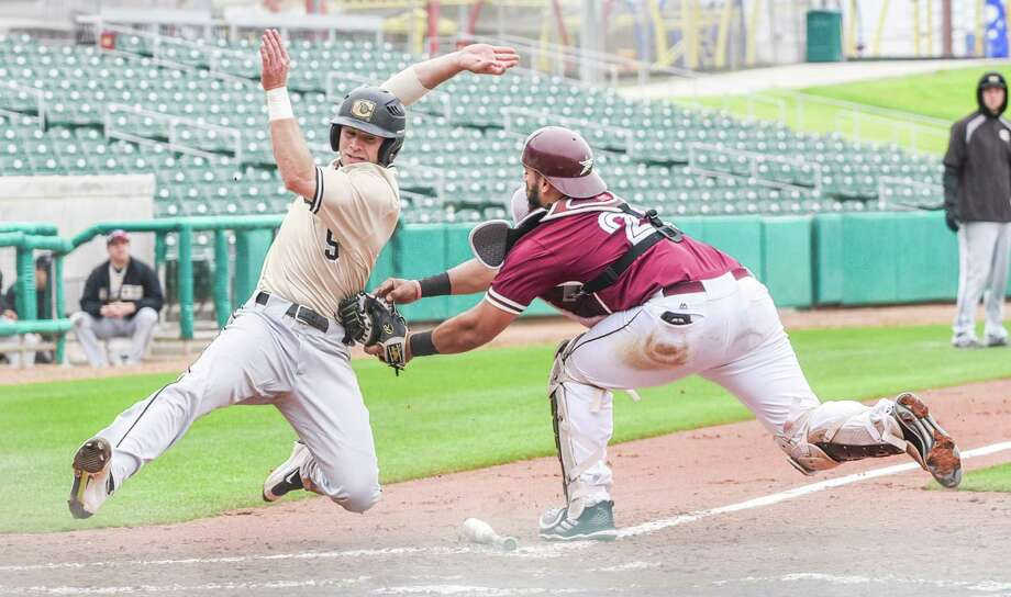 TAMIU catcher Matthew Rosales tags out Cameron's Mitch Sloan at the plate Friday at Uni-Trade Stadium. The Dustdevils fell to 0-2 for the first time since 2007 while Cameron begins the year 4-1. Photo: Danny Zaragoza /Laredo Morning Times
