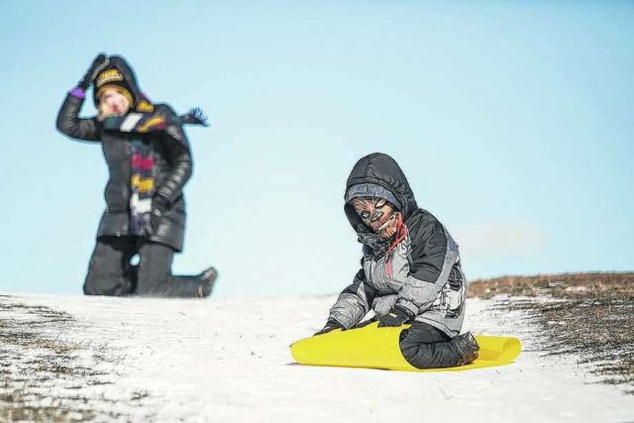 Charlotte Ruprecht watches as her 6-year-old son, Max Ruprecht, sleds at Cricket Hill near Montrose Beach.