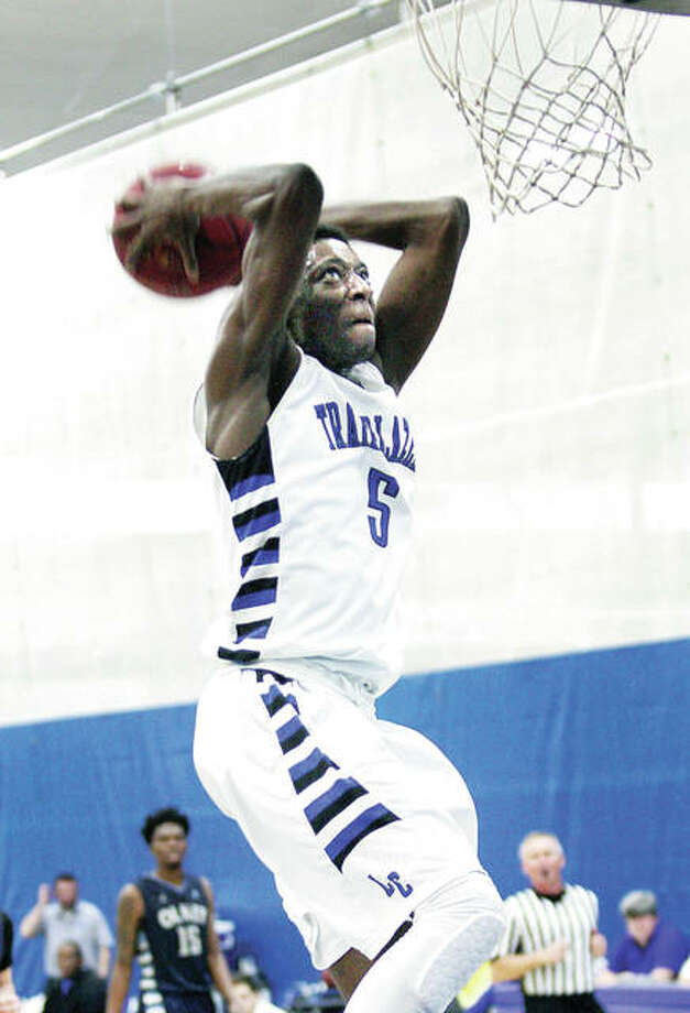 LCCC's Tobi Ewuosho eyes the rim as he goes up for a dunk Monday night against Olney Central College at the River Bend Arena. Ewuosho, a freshman from Chicago Lincoln Park High, scored 18 points, but LCCC lost the Region 24 play-in game 81-64. LCCC's Tobi Ewuosho eyes the rim as he goes up for a dunk Monday night against Olney Central College at the River Bend Arena. Ewuosho, a freshman from Chicago Lincoln Park High, scored 18 points, but LCCC lost 81-64. Photo: James B. Ritter | For The Telegraph