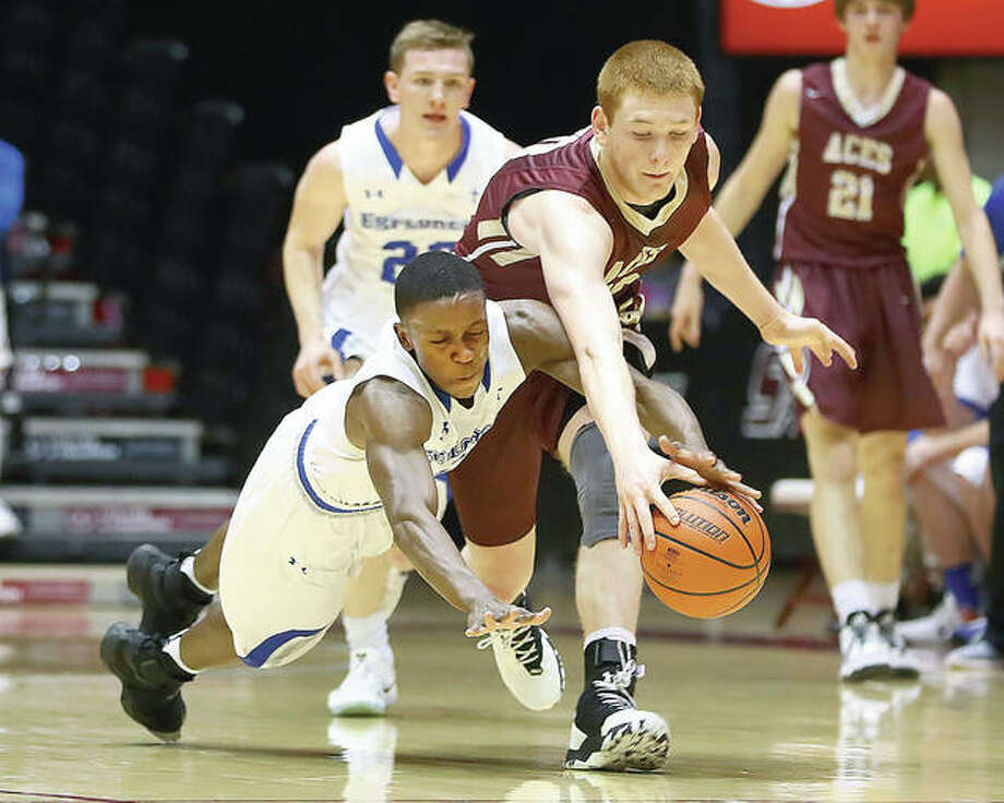 Marquette's Bryce Pettiford, left, dives for a loose ball along with Mount Carmel's Justin Carpenter during Tuesday night's Carbondale Class 2A Super-Sectional at the SIU Arena. Photo: Billy Hurst | For The Telegraph