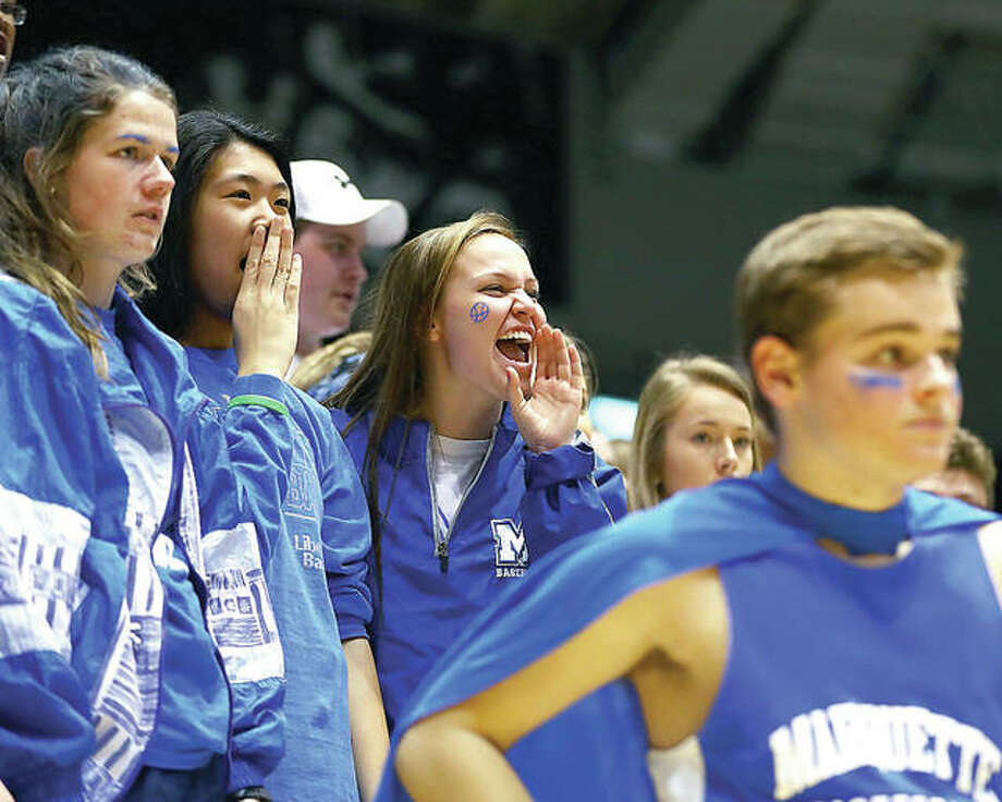 Marquette Catholic High fans shout encourgement during the IHSA Carbondale Class 2A Super-Sectional against Mount Carmel at the SIU Arena. Mount Carmel defeated the Explorers 61-40. Photo: Billy Hurst | For The Telegraph