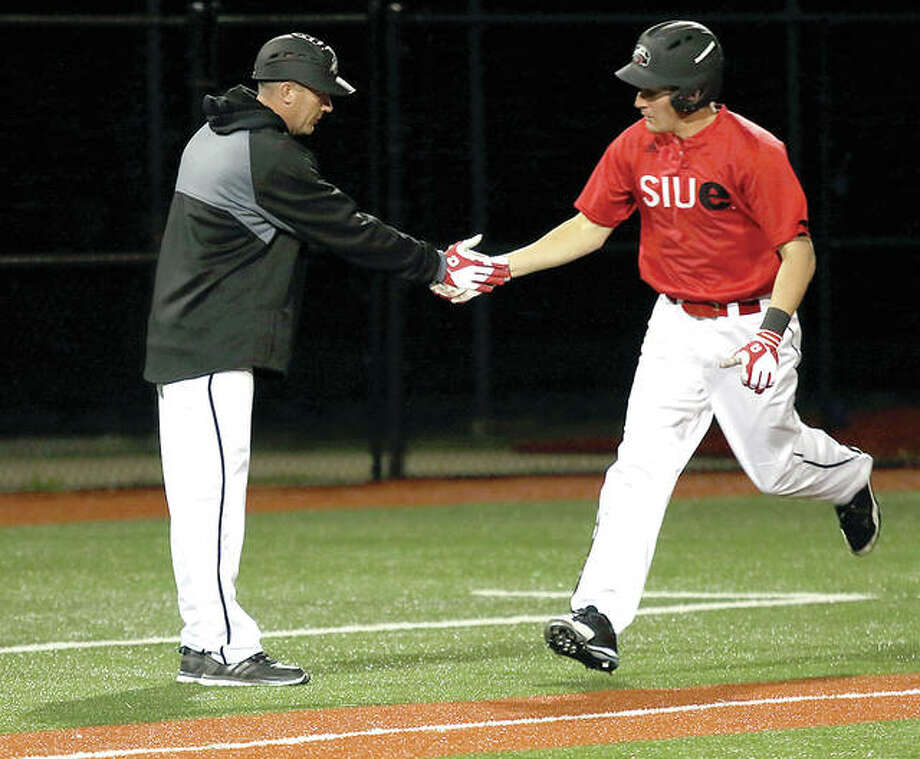 SIUE's Jared McCunn, right, is congratulated by coach Sean Lyons after his fourth-inning home run in Wednesday night's 12-12 loss to Saint Louis University at SIUE. Photo: Courtesy Athlete's Eye