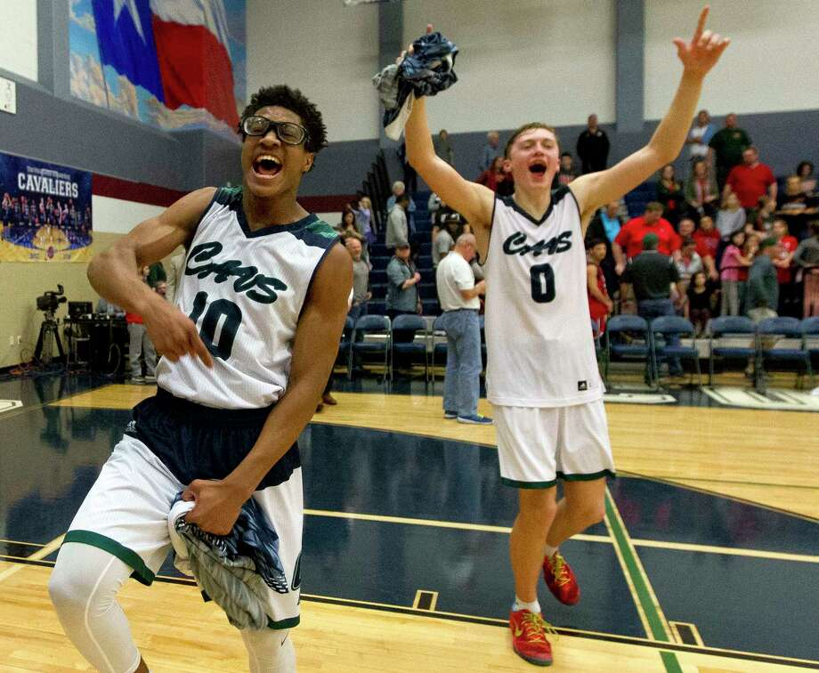 College Park guard Trey Grigsby (10) and forward Max Bowman (0) react after defeating The Woodlands 87-79 during District 12-6A high school basketball game at College Park High School, Friday, Feb. 9, 2018, in The Woodlands. Photo: Jason Fochtman, Staff Photographer / © 2018 Houston Chronicle