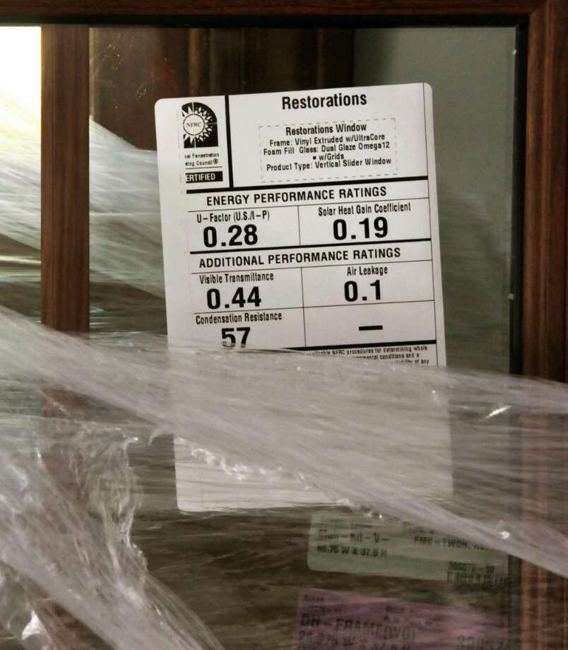 A LABEL gives the energy efficiency on windows being installed by R.M. Pena Inc. (John Carl D?Annibale / Times Union) Photo: John Carl D'Annibale / 00004717A