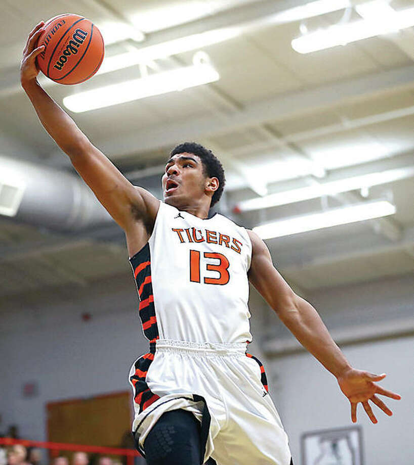 Edwardsville's Mark Smith scored 45 points to lead the Tigers to an 81-59 victory over Danville on Friday night in the championship game of the Ottawa Class 4A Sectional Tournament. Photo: Billy Hurst | For The Telegraph