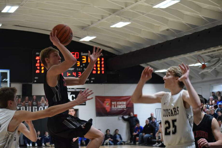 Chandles Sievers goes for the basket Saturday during the consolation championship game at the Winchester Invitational. Photo: Audrey Clayton | Journal-Courier