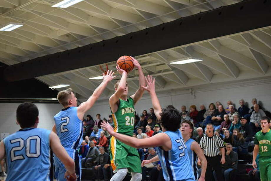 Brown County's Nathan Hendricker attempts a shot against Triopia Saturday. Photo: Audrey Clayton | Journal-Courier