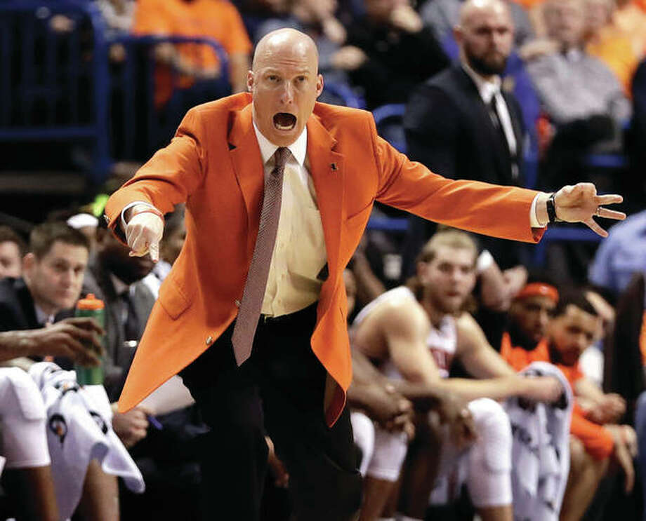 Illinois coach John Groce reacts to a play during an Illini victory over Missouri on Dec. 21 in St. Louis. Groce was fired as Illinois coach on Saturday. Photo: Associated Press