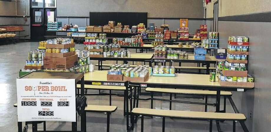 Members of the Franklin Community Unit School District 1 community — faculty, staff and students — recently held a food drive in support of Franklin Lions Club's annual Christmas food basket drive. The district collected 2,499 food items for the baskets, while the Franklin High School Student Council donated flour, sugar and rice for each basket. The Lions Club donated ham, eggs, butter, milk, potatoes, bread and oranges. The drive, a Lions Club tradition for more than 50 years and a school district tradition for more than 30 years, resulted in 40 baskets being made and delivered Dec. 16. Surplus food was donated to Franklin Christian Church's food pantry. Among notable donations from the school district, the junior high donated 1,080 food items — almost 500 more items than it donated in 2016. The sixth-grade class was responsible for 443 of those items. The high school donated 555 items, 150 more than in 2016 and led by the junior class total of 391 items donated. Faculty and staff collected 864 items in addition to donating 31 smoke or carbon monoxide detectors. Photo: Photo Provided
