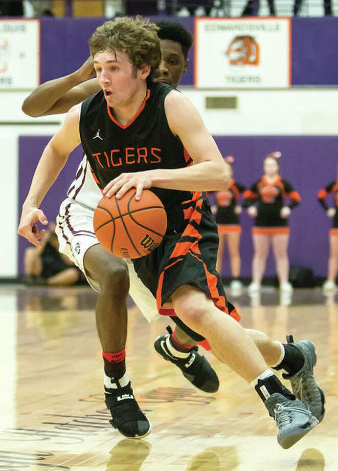 Edwardsville's Jack Marinko drives past a Belleville West defender during last Tuesday's sectional win at Collinsville. The Tigers are back in action Tuesday in the Normal Class 4A Super-Sectional at Redbird Arena in Normal. Photo: Scott Kane / For The Telegraph
