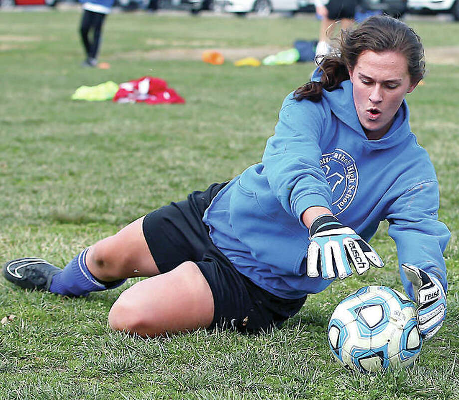 Marquette Explorers goalie Lauren Fischer makes a save during a preseason practice at Glazebrook Park in Godfrey. Photo: Billy Hurst | For The Telegraph