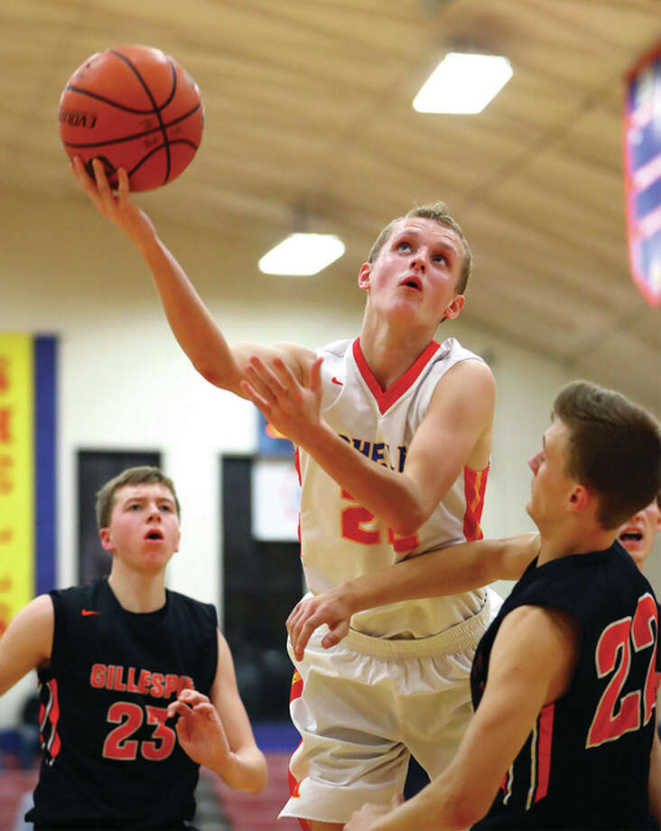 Roxana's Zach Golenor (middle) and Gillespie's Nick Price (right) will be teammates in Sunday's Carlinville Rotary Club/Country Financial All-Star Basketball Classic to be held Sunday at Carlinville High School. They are pictured playing against each other in a regular-season contest at Roxana. Photo: File Photo