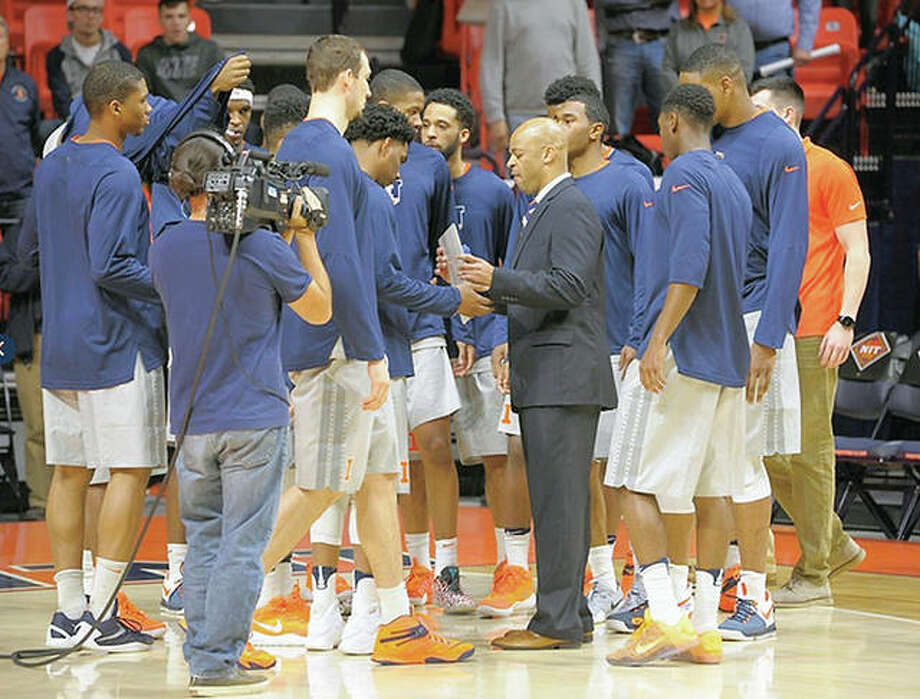 Interim Illinois basketball coach Jamall Walker, center, speaks with the team during Tuesday night's NIT opener against Valparaiso at State Farm, Center in Champaign. Walker is a former assistant coach at Alton High sShool. Photo: Mark Jones | Illinois Athletics