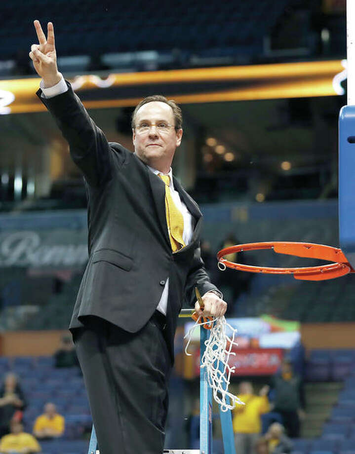 Wichita State head coach Gregg Marshall celebrates by cutting down the net after the Shockers beat Illinois State 71-51 to win the Missouri Valley Conference Tournament Sunday in St. Louis. Photo: AP