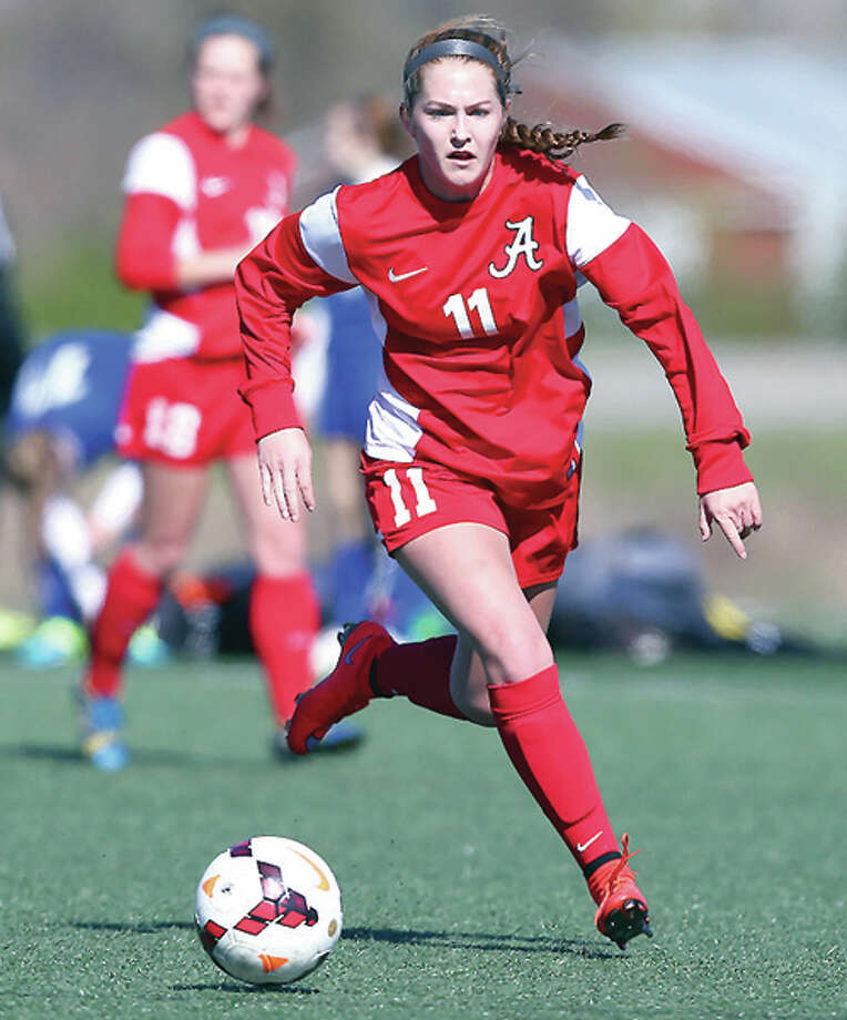 Alton's Brianna Hatfield scored a pair of long-range goals Friday night to lead Alton pastColumbia 2-1 on a semifinal of the Metro Cup Tourney Nike Division. She is shown in action during a game last season. Photo: Billy Hurst File Photo