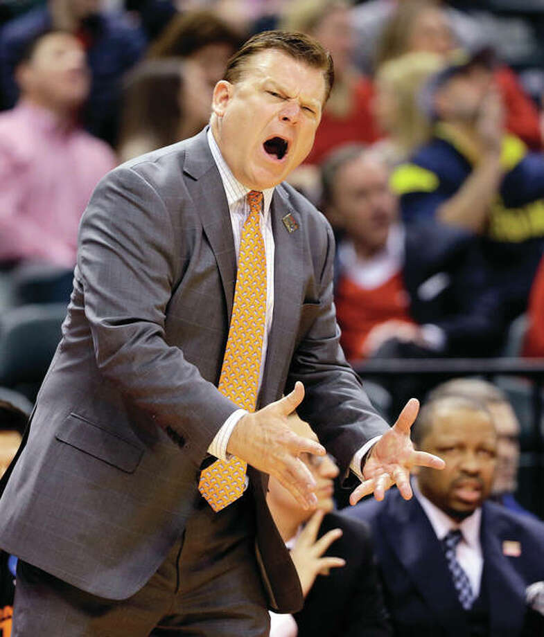 Oklahoma State coach Brad Underwood yells from the sideline during Friday's loss to Michigan in the NCAA Tournament's first round in Indianapolis. Underwood on Saturday was named the new head coach at Illinois. Photo: Associated Press