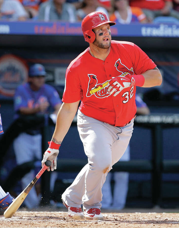 The Cardinals' Matt Adams, shown in action last year, has shed some 30 pounds through an off-season conditioning program and may see some action this season in the outfield. Photo: AP File Photo
