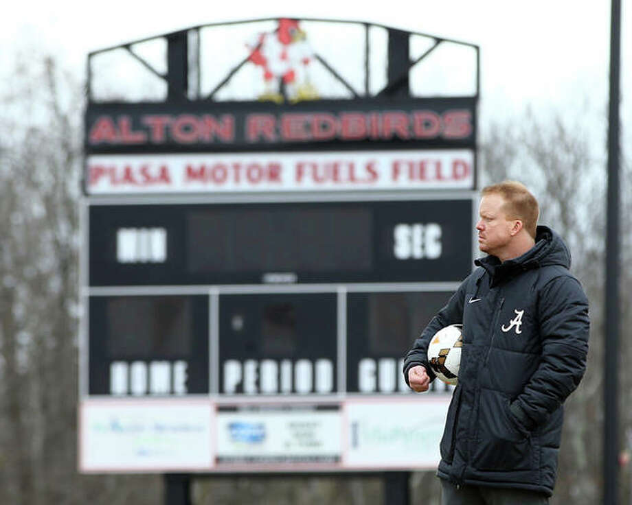 Alton High girls soccer coach Jeff Hayes has his team off to a 3-0 start after the Redbirds won their second consecutive Metro Cup title Saturday night with a 3-2 win over Belleville Althoff. Photo: Billy Hurst | For The Telegraph