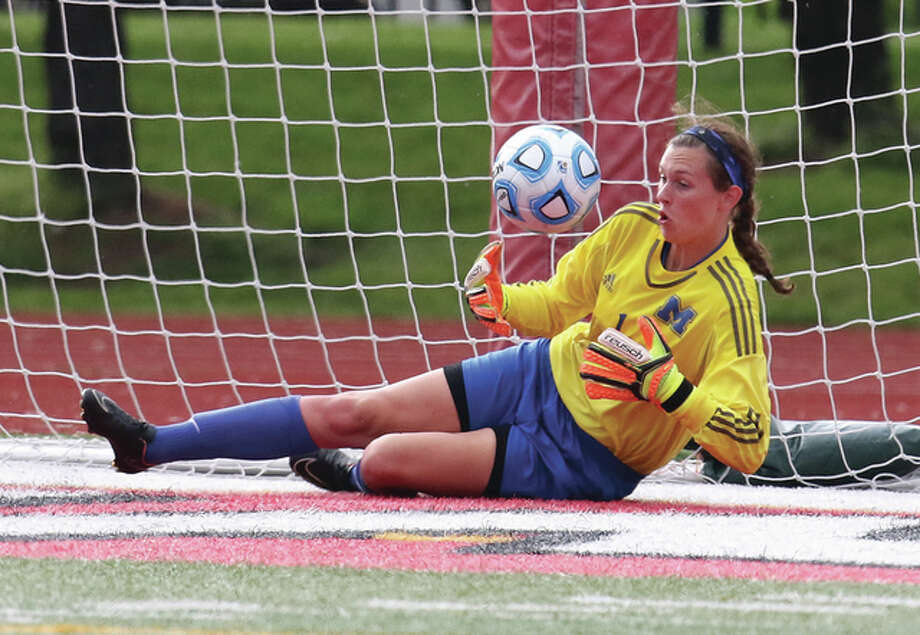 Marquette Catholic High goalie Lauren Fischer came up with a pair of overtime penalty kick saves Saturday in a Metro Cup game against Waterloo. The Explorers survived the shootout after playing the Bulldogs to a 1-1 regulation tie. Last season, Fischer and the Explorers won three consecutive overtime shootouts in the playoffs. She is shown making a save against Wheaton Academy in the Class 1A state semifinals in Naperville. Photo: Telegraph File Photo