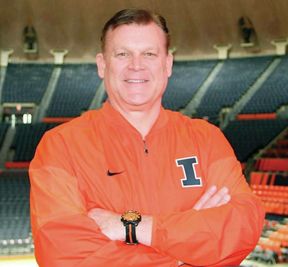 New University of Illinois basketball coach Brad Underwod poses Saturday at his new place of employment, State Farm Center in Champaign. Photo: Derek Neal, Illinois Athletics