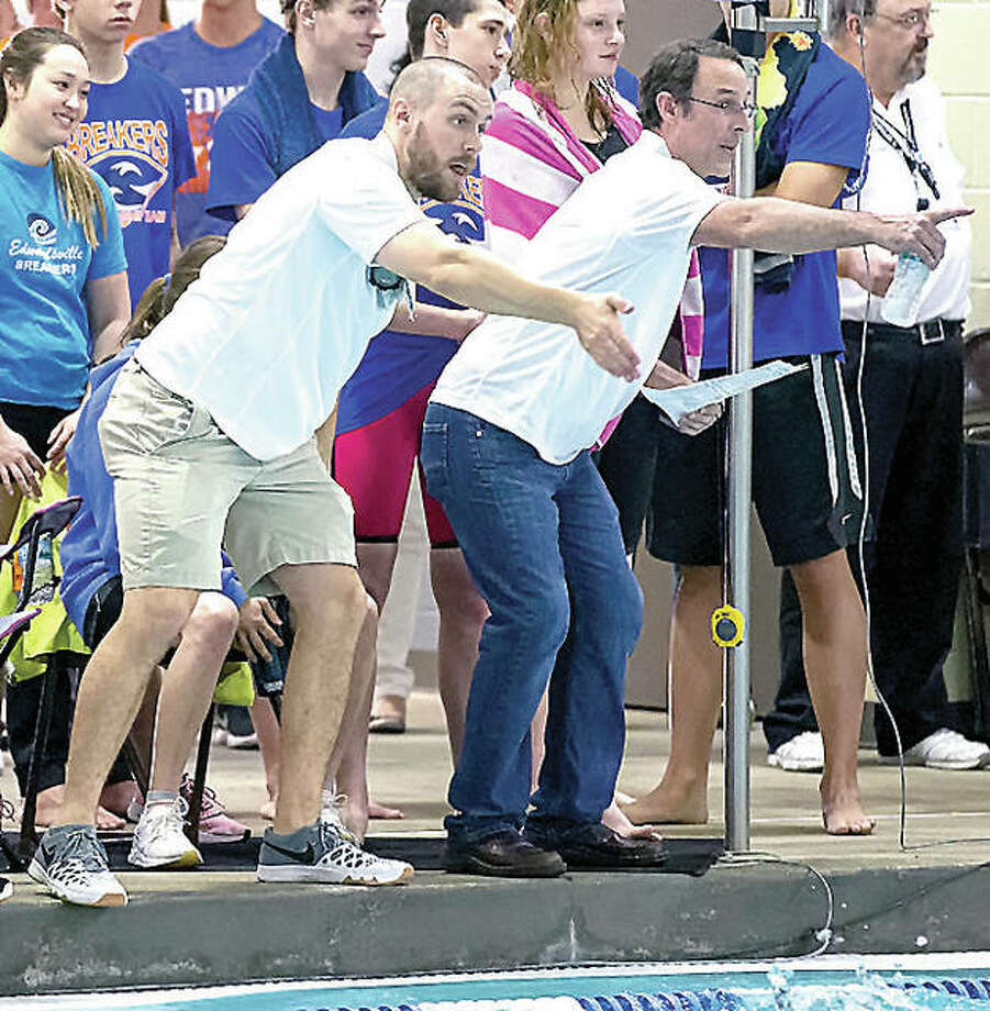 Edwardsville YMCA Breakers head coach Bob Rettle, right, and assistant coach Christian Rhoten cheer on their swimmers during a race at the Heartland Area Championships in Edwardsville. Photo: Scott Kane | For The Telegraph