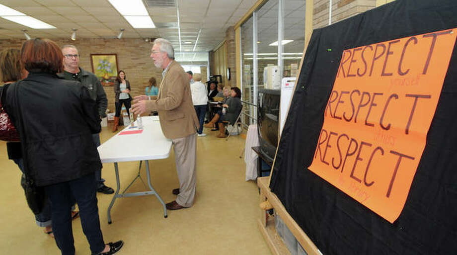 "Mayoral candidate Tom Kane talks to visitors during Saturday's ""Meet the Candidates"" event at the Wood River Public Library. Photo: David Blanchette 