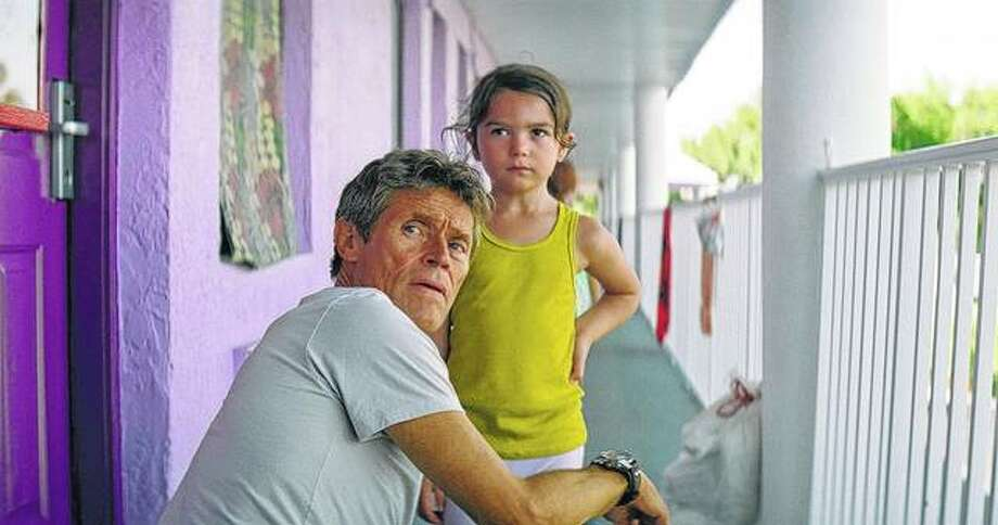 "Willem Dafoe (left) as motel manager Bobby and Brooklynn Prince at 6-year-old Moonee share a scene in ""The Florida Project."" Photo: A24 