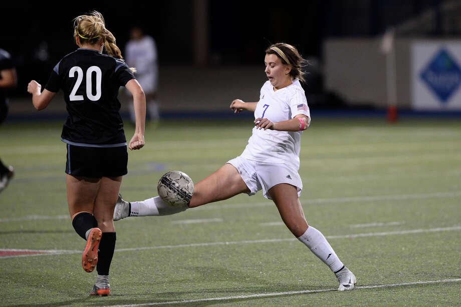 Midland High's Kylie VonHolle kicks the ball away from Permian's Briana Moore (20) on Feb. 9, 2018, at Grande Communication Stadium. James Durbin/Reporter-Telegram Photo: James Durbin