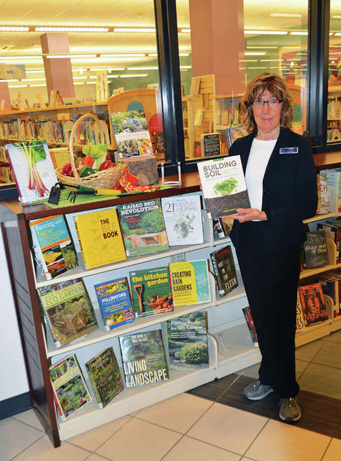Book displays with a range of garden topics are arranged by Jean Shimunek to encourage program attendees to do further research on their own.