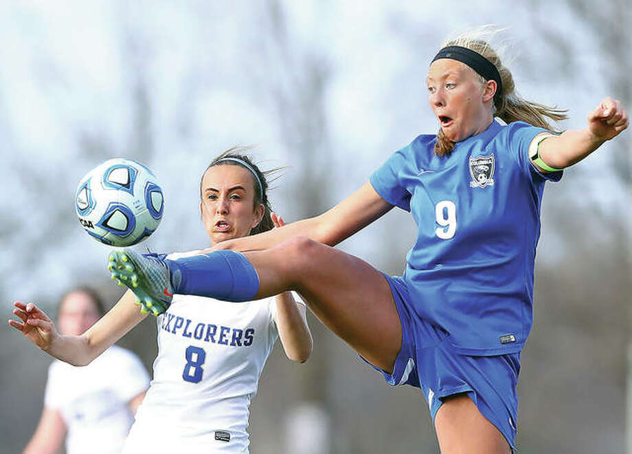 Columbia's Madelyne Juenger, right, jumps for a ball in front of Marquette's Anna Boschert during Tuesday's game at Gordon Moore Park. Columbia won 1-0. Photo: Billy Hurst   For The Telegraph