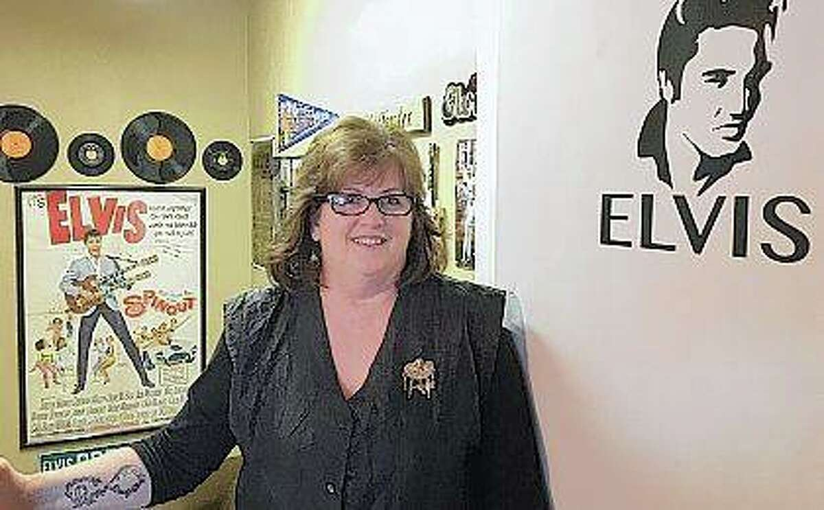 """Hairstylist Jackie Wagher stands at the entrance to her hair salon, Jackie's Hair Care, in her home in Knoxville. Wagher, a big Elvis fan, has adorned her salon and home with memorabilia. """"Elvis was the first man I loved. I remember Elvis was the man I wanted to marry,"""" Wagner said. By age 15, Wagher started collecting Elvis keepsakes. Tom Loewy   Register-Mail (AP)"""