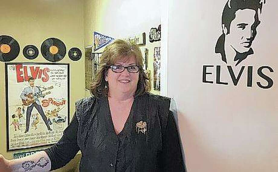 "Hairstylist Jackie Wagher stands at the entrance to her hair salon, Jackie's Hair Care, in her home in Knoxville. Wagher, a big Elvis fan, has adorned her salon and home with memorabilia. ""Elvis was the first man I loved. I remember Elvis was the man I wanted to marry,"" Wagner said. By age 15, Wagher started collecting Elvis keepsakes. Tom Loewy 