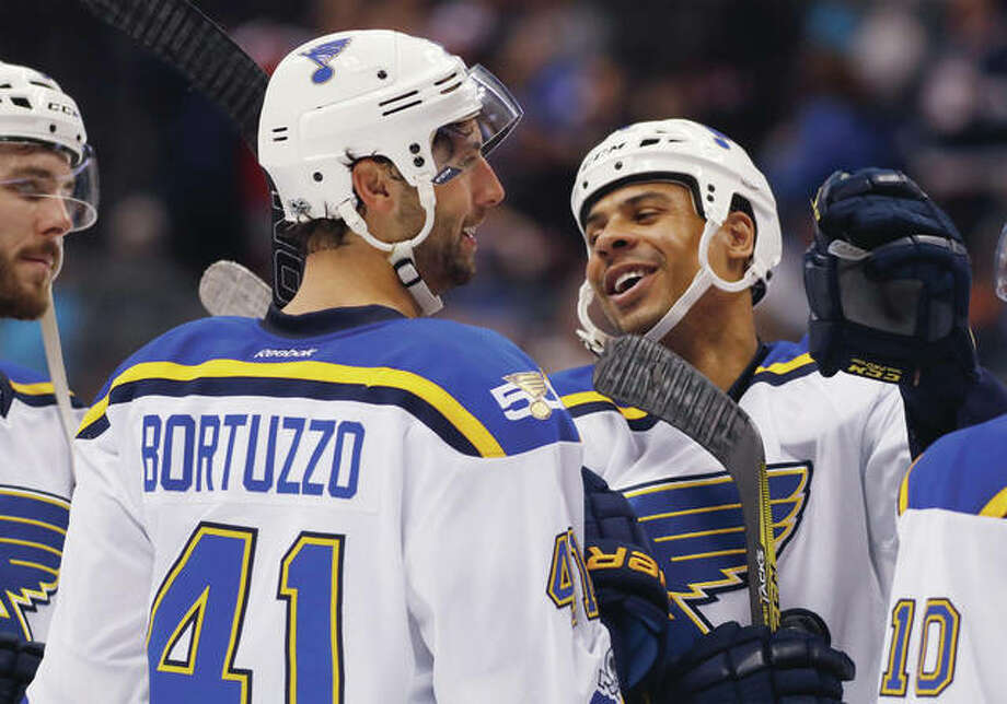 The Blues' Ryan Reaves (right) celebrates with teammate Robert Bortuzzo after time ran out in the third period of the Blues win over the Colorado Avalanche on Tuesday night in Denver. Photo: Associated Press