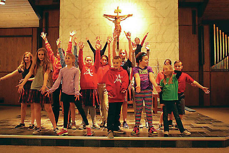 "St. Ambrose Catholic School Drama Club's ""Once on This Island Jr.'s"" cast and crew are made up of 30 students ranging from third to eighth grades, who have worked on the show for more than three months. The show is directed by St. Ambrose Principal Jean Heil with music and artistic direction by St. Ambrose fine arts teacher Karie Preston. Photo: For The Telegraph"