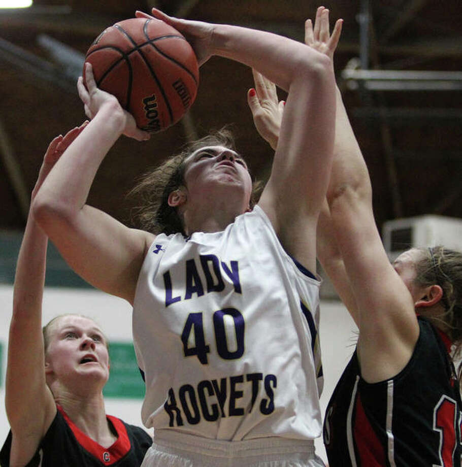 Routt's Katie Abell rises for a shot during a girls' basketball game against Calhoun Monday night at the Routt Dome in Jacksonville. Photo: Dennis Mathes | Journal-Courier