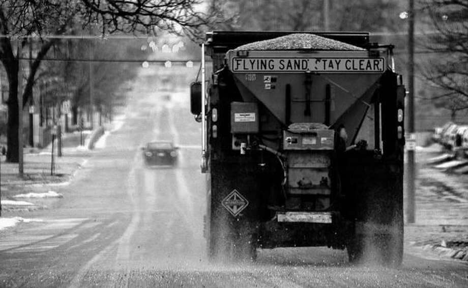 A truck spreads salt after a winter storm. Scientists are starting to raise concerns about road salt's impact on the environment, especially drinking water, because lakes and streams near roads are showing elevated levels of sodium and chloride. Eric Gregory | The Journal Star (AP)