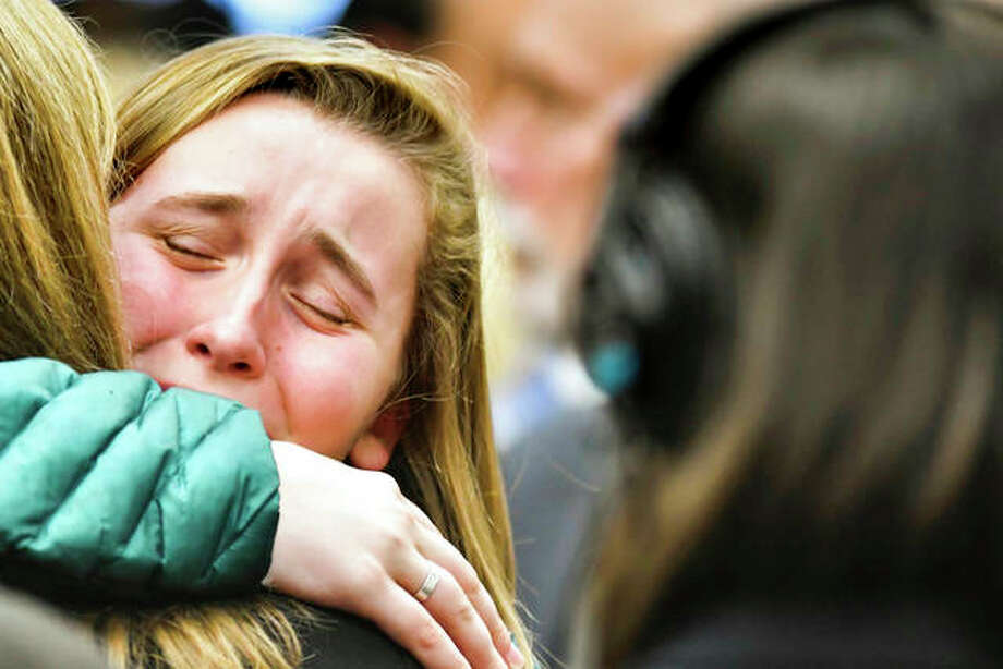 """People in the gallery react after a sentencing hearing for Larry Nassar. The former sports doctor who admitted molesting some of the nation's top gymnasts for years was sentenced to 40 to 175 years in prison as the judge declared: """"I just signed your death warrant."""" Matthew Dae Smith 