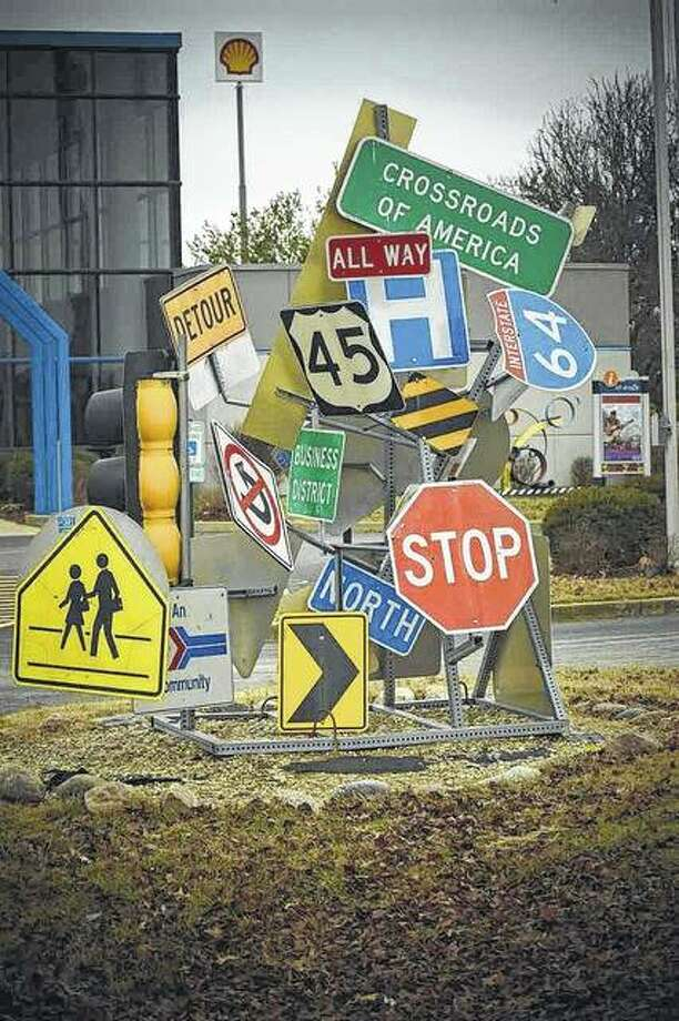Signs fill an intersection in Mount Vernon. The amalgamation of road signs is one of the public art pieces in the city.