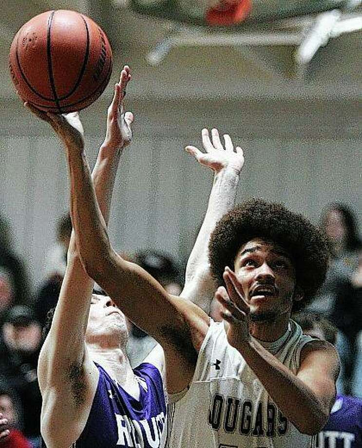 West Central's Derick Montgomery puts up a shot during a boys' basketball game against Routt Tuesday night. Photo: Dennis Mathes | Journal-Courier