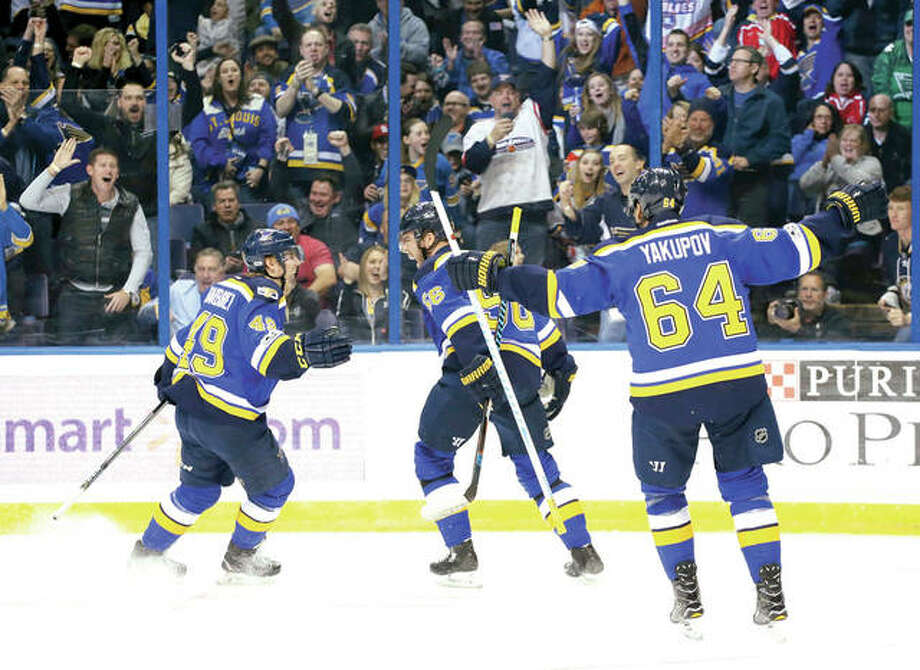 Blues left wing Magnus Paajarvi, center, reacts after center Ivan Barbashev, left, and right wing Nail Yakupov both assisted on his goal in the first period Thursday night against the Vancouver Canucks in St. Louis. Photo: AP