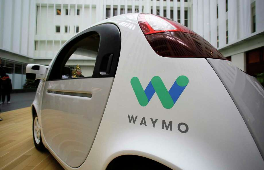FILE - In this Dec. 13, 2016, file photo, the Waymo driverless car is displayed during a Google event in San Francisco. Uber is settling a lawsuit filed by Google's autonomous car unit alleging that the ride-hailing service ripped off self-driving car technology. Both sides in the case issued statements confirming the settlement Friday, Feb. 9, 2018, morning in the midst of a federal court trial in the case. (AP Photo/Eric Risberg, File) Photo: Eric Risberg, STF / Copyright 2016 The Associated Press. All rights reserved.