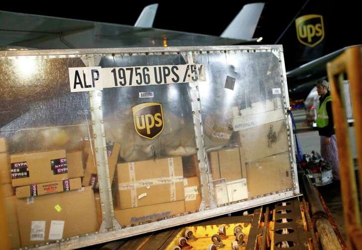 In this Nov. 20, 2015 picture, a UPS airplane is unloaded at the company's Worldport hub in Louisville, Ky. Shares of delivery companies FedEx and UPS are falling in Friday, Feb. 9, 2018, premarket trading following a report that powerhouse Amazon is readying its own delivery service for businesses.  (AP Photo/Patrick Semansky)