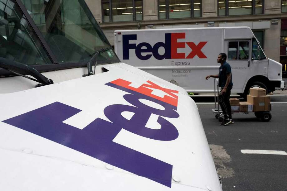 In this Tuesday, Aug. 22, 2017, photo, FedEx trucks are parked in New York. Shares of delivery companies FedEx and UPS are falling in Friday, Feb. 9, 2018, premarket trading following a report that powerhouse Amazon is readying its own delivery service for businesses. (AP Photo/Mark Lennihan, File) Photo: Mark Lennihan, STF / Copyright 2017 The Associated Press. All rights reserved.