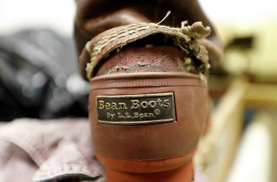 A Bean Boot made its way to the return bin at L.L. Bean's retail store in Freeport, Maine. Although the company is changing its return policy, it says it will always accept returns on products that have failed, such as this boot. Photo: Robert F. Bukaty, STF / Copyright 2018 The Associated Press. All rights reserved.