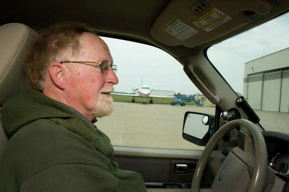 David Miller drives by a jet being overhauled by West Star Aviation while inspecting St. Louis Regional Airport, where he is the manager, on Friday. West Star has announced plans to bring a new hangar to the airport.