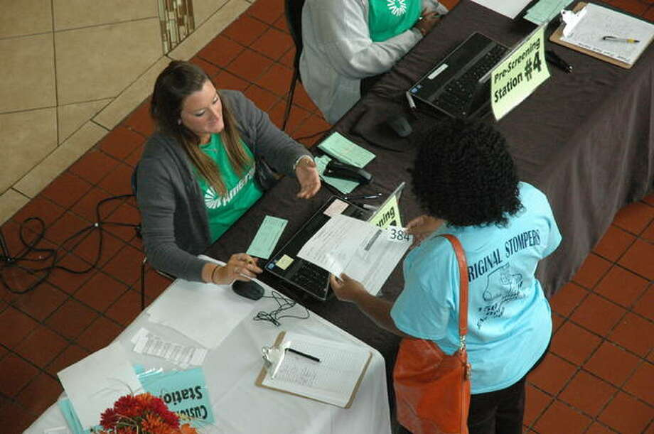An Ameren representative speaks with a customer at last year's customer outreach event in East St. Louis.